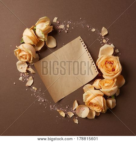 Sheet of blank paper with round framed flowers, copy space
