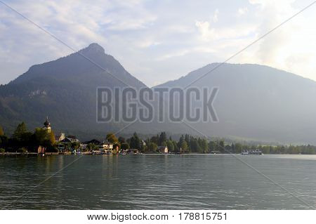 Travel To Sankt-wolfgang, Austria. The View On The Lake With The Buildings And The Mountains On The