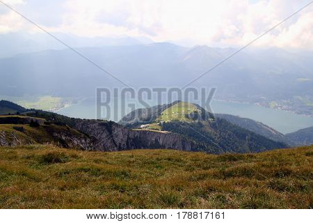 Travel To Sankt-wolfgang, Austria. The View On The Mountains And A Lake In The Clouds.