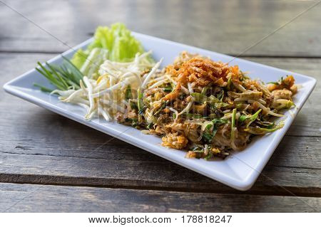 pad thai or the thai style noodle on wood table