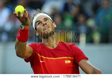 RIO DE JANEIRO, BRAZIL - AUGUST 12, 2016: Olympic champion Rafael Nadal of Spain in action during men's singles semifinal of the Rio 2016 Olympic Games at the Olympic Tennis Centre
