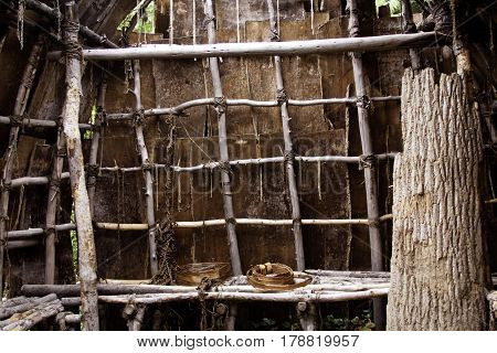 Plimoth Plantation, Plymouth, Massachusetts - September 10, 2014 - Close up view of the interior of a Wampanoag Indian hut made of branches and covered in vibrant bark in the Wampanoag Indian Village at Plimoth Plantation, Plymouth, on a bright sunny day