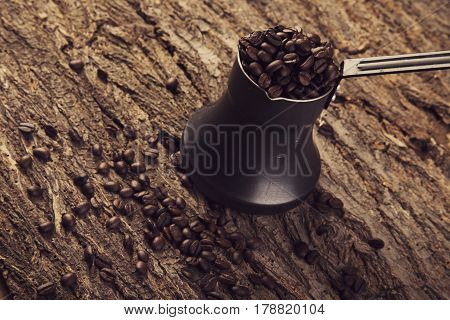 Turk coffee with coffee beanson a wooden bg poster