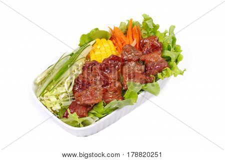 Thai food Mixed vegetable salad topped sliced grilled pork as green oak cucumber  sweet corn carrot and cabbage Salad Moo Yang in Thai. Isolated on white background.