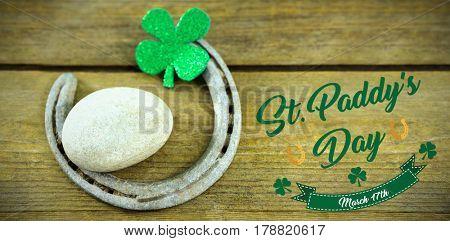 Print against st patricks day shamrocks with horseshoe and pebble