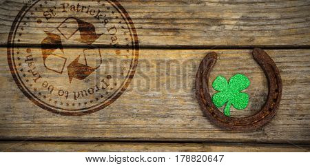 Composite image of St Patrick Day with recycling symbol against horse shoe and shamrock