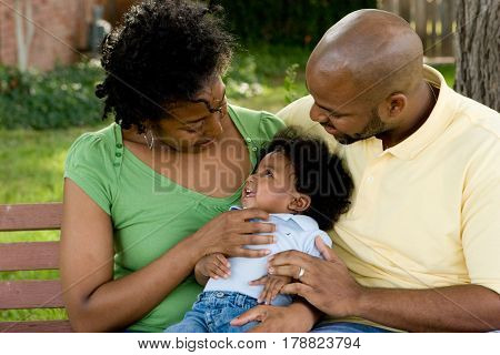 Loving African American family with thier little boy.