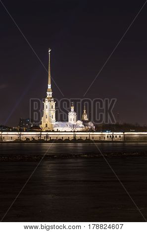 Night cityscape of the spire of peter and paul cathedral