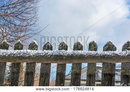 Acute Narrow Boards Of An Old Fence Covered With Snow.