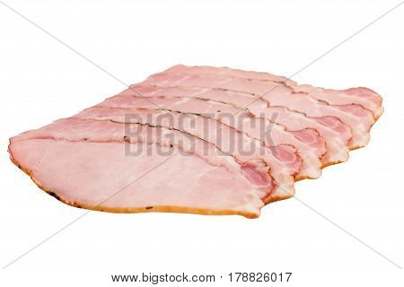 low angle side view of slices of smoked pork loin ham arranged in a stack isolated on white background