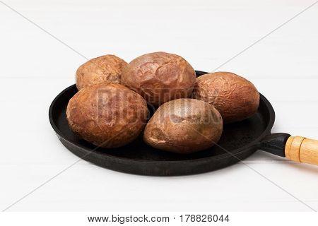 Five Baked Jacket Potatoes White Background