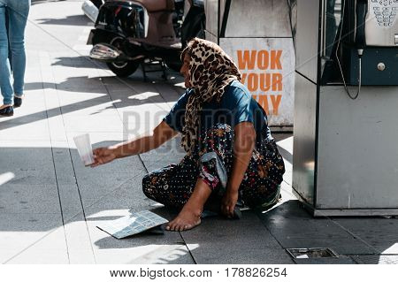 Madrid Spain - September 18 2016: Unidentified woman beggar asked for money on a busy street in the center of Madrid