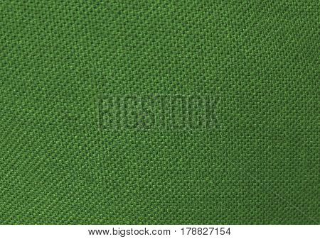 Textile Texture Close Up of Green Sack or Burlap Fabric Pattern Background.