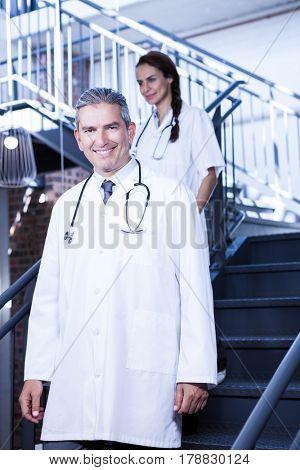 Doctors walking down stairs in hospital