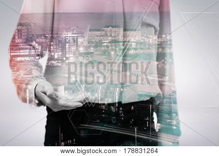 Businesswoman gesturing against white background against illuminated buildings in city 3d