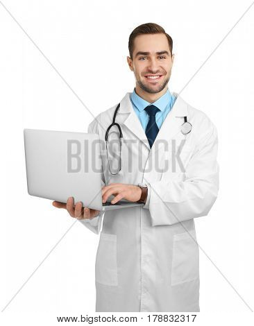 Handsome young doctor with laptop on white background