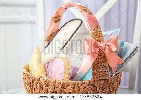 Easter basket with cookies and stationery on white chair
