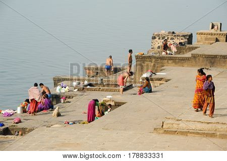 People Washing Clothes On Sacred River Narmada Ghats At Maheshwar