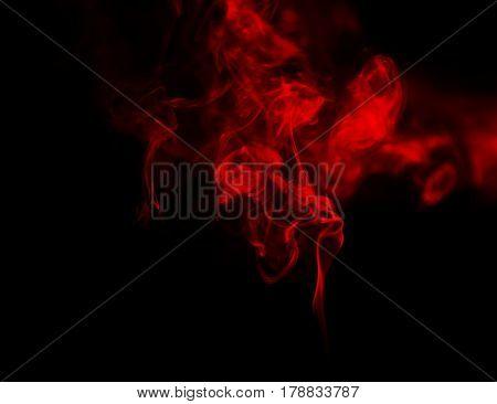 Swirl of red smoke on dark background