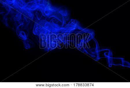 Swirl of blue smoke on black background
