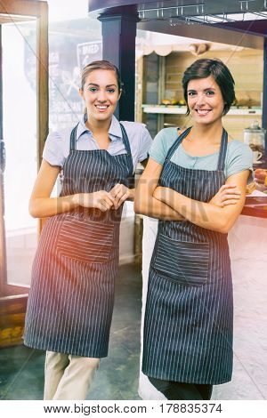 Portrait of pretty waitresses smiling in coffee shop