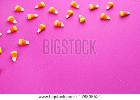 Tasty Halloween candies on color background