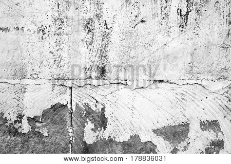 Old concrete wall with peeling white paint layer background photo texture