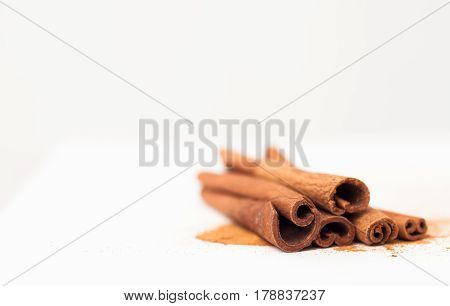 Cinnamon Sticks On White Background, Place For Text