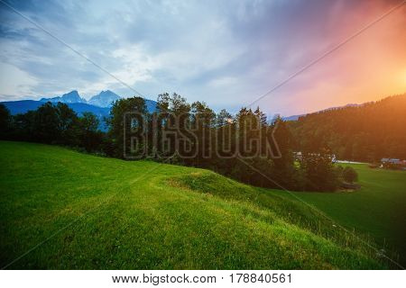 The countryside in twilight. Wonderful and gorgeous scene. Location place Berchtesgaden land Bavaria, Germany alp, famous Watzmann peak, sightseeing Europe. Vacation time. Explore the world's beauty.