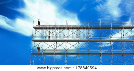 Smiling architect with hard hat against blue sky with clouds 3d