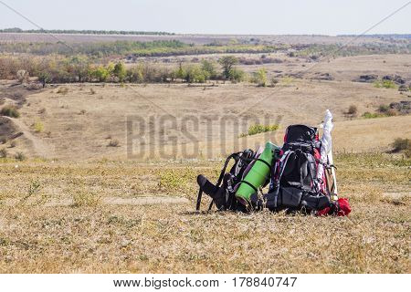 the two tourist backpack at nature landscape