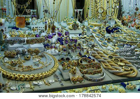 FLORENCE ITALY - SEPTEMBER 11 2008: Golden jewellery in showcase of the shop on Ponte Vecchio bridge in Florence Italy on September 11 2008.