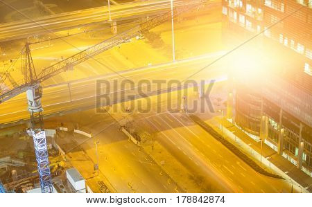 Blurry animated flare against high angle view of glowing road
