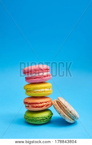 Delicious stack of colorful homemade macaroons. Homemade and colorful macaroon cookies tower