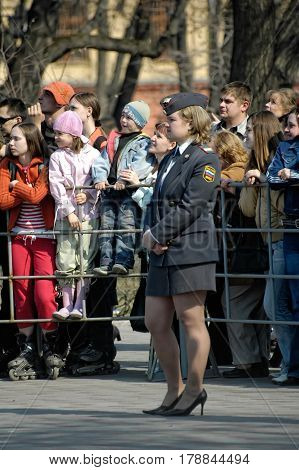 Tyumen, Russia - May 9. 2006: Victory Day holiday. Young policewoman - senior lieutenant stands and protects an order during parade