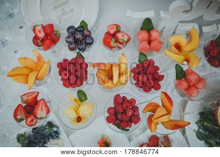 Fruit table for the celebration of the wedding. Decor trend