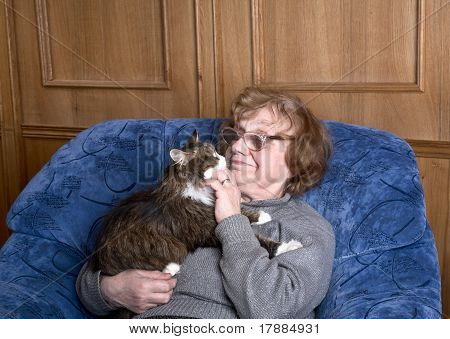 Old Woman In An Armchair With A Cat
