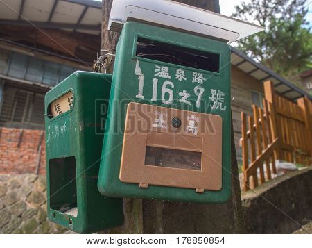 Beitou Taiwan - October 06 2016: Grenn mailbox with Chinese titles