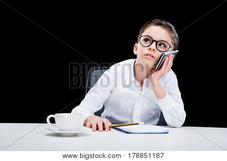 Little Girl Businesswoman Talking On Smartphone And Taking Notes