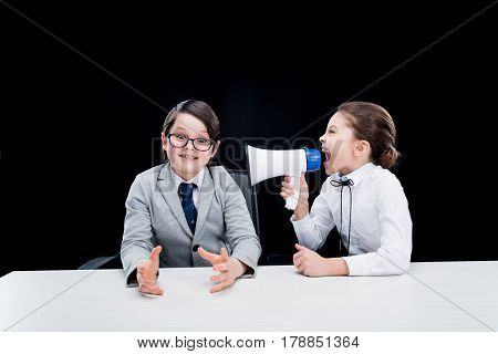 Boy And Girl In Formal Wear Interacting With Bullhorn On Black