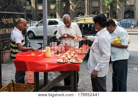 Vendor Sells Fruit Salad In A Street On Mumbai