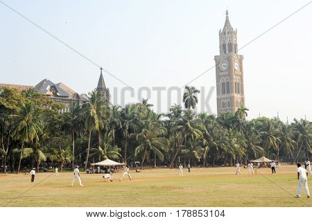 People Playing Cricket In Front Of Rajabai Tower At Mumbai