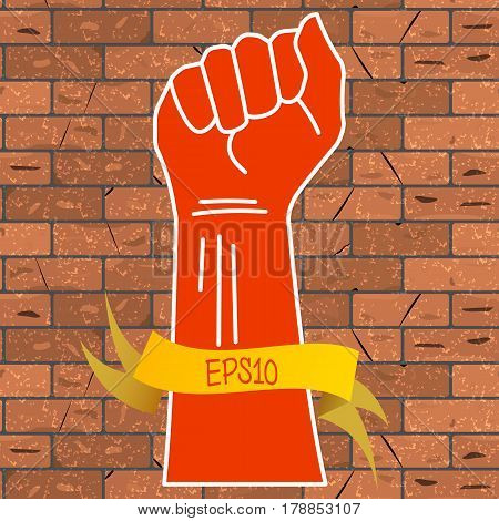 Vector illustration of a red hand clenched into a fist and a yellow ribbon with an inscription EPS10 on a brown brick wall background