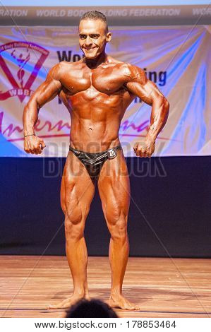 MAASTRICHT THE NETHERLANDS - OCTOBER 25 2015: Male bodybuilder flexes his muscles and shows his best chest pose at the World Grandprix Bodybuilding and Fitness of the WBBF-WFF