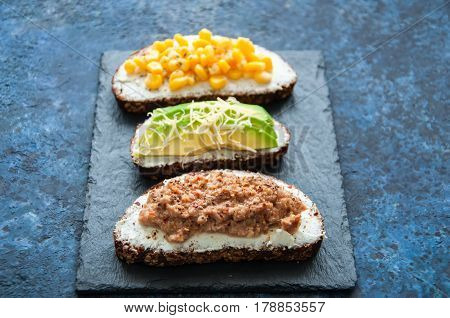 Mix Of Rye Bread Bruschettas With Various Filling. Sweet Corn Omlet Tuna Seeds Cheese Avocado Sandwi