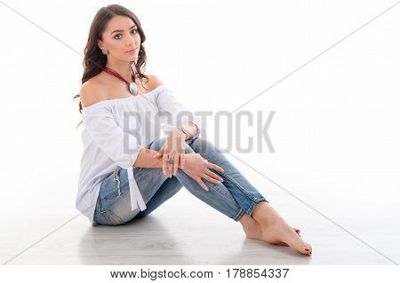 brunette long hair female model wearing luxury silver accessory and jewelry. Sitting Girl Isolated on white background