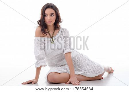 Posing young model wearing luxury silver accessory and jewelry. Girl Isolated on white background