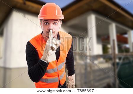 Male Construction Worker Shushing