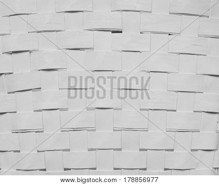 Texture of white woven paper strips for background.