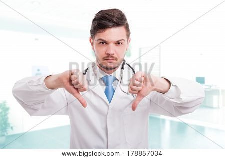 Caucasian Male Doctor Showing Double Thumb Down Sign